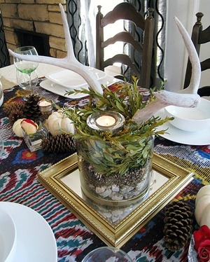 rustic wedding centerpiece with pinecones on a mirror