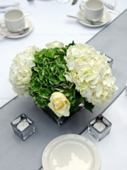 white and green hydrangea wedding centerpiece