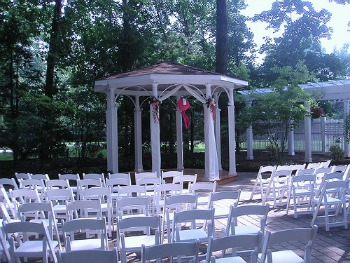 wedding gazebo decorated with ribbons and paper lantern