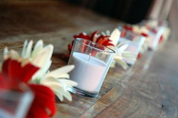 glass votives and flower centerpieces