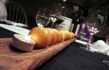 orange and candles fruit wedding centerpiece