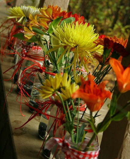 orange yellow flowers for rustic wedding centerpiece