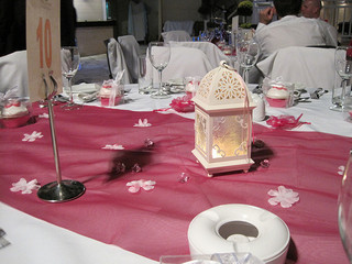 pink table runner with white lantern