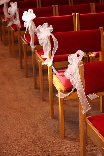tulle bows on chair pews