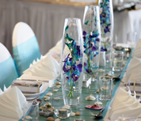 Blue Orchid Centerpieces would look fab for your theme.