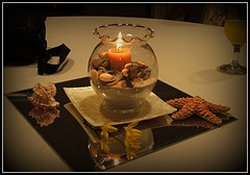 beach centerpiece with candles and shells