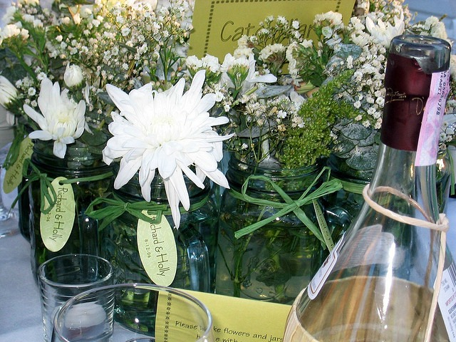 jars filled with white flowers