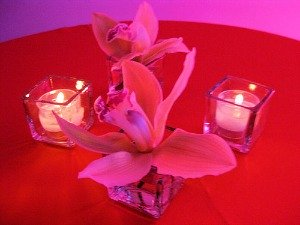 pink orchid and candle table decoration