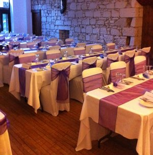 wedding tables with purple table runners
