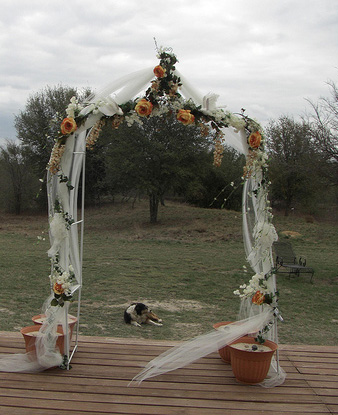 tulle decorated wedding arch